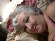 ature Dana Tickled in Red Stockings - view only her face