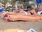 Sunbathing Mature plays sexy with her feet