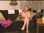 Scottish gran Busty talks and strips