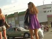 Delicious redhead in purple dress on the street