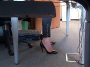 dangling louboutin under desk 2