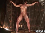 Muscled woman in a BDSM casting