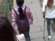Amputee Chinese Girl Down Stairs With Crutches