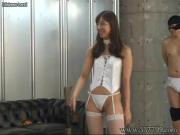 Domina who knocks slaves with a whip