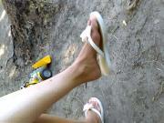 Her Feet in Flip Flops