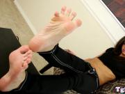 TS babe arches her feet during footfetish