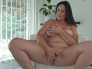 Curvy milf Ria Black strips off her clothes and finger fucks