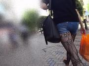 Denim Shorts And Black Patterned Tights