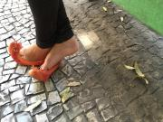 Candid girl feet in street