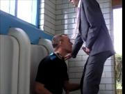 Sucking a suited married daddy in a secluded restroom