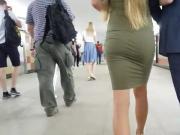 Slim blonde's ass in tight dress