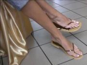 Incredible long feet and toes in very cute cork flip-flops.