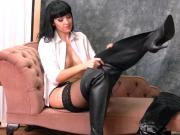 Kinky brunette in leather boots nylons panties suspenders