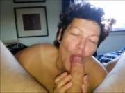she is enjoying sucking on a large one