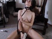 Hitachi and a belt around her neck