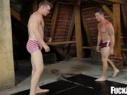 Hunky wrestlers bareback fuck deeply after the match