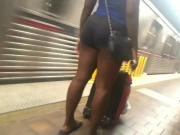 Hoochie black legs and ass street voyeur