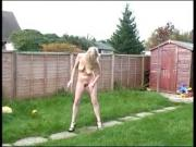 UK skinny mature watering the garden.mp4
