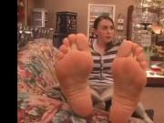 Pretty brunette remove socks and show wonderful soles feet