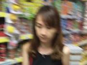 MILF in black dress supermarket face