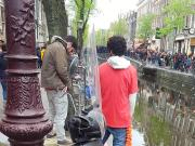 2 guys pissing on the street in Amsterdam