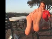 She shows her soles and feet