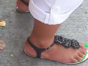 west indian feet at bus stop