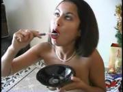 Cute woman brushes her teeth with cum