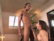 Sexy black babe gets on her knees to sucks guys hard cock