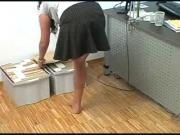 Leg amputee girl in her office showing her leg stump