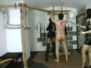 Two young ladies whipping male slave 01