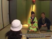 Asian babe in a kimono sucking on his erect prick