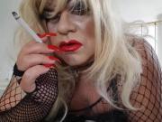 Crossdresser smoking red lipstick long red nails