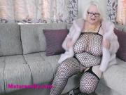 Hot Granny in a fur coat and fishnets