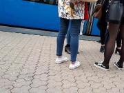 Girl wait for tram 7 black stockings