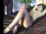 Brunette Modeling In Black pantyhose