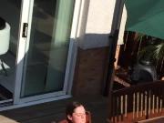Neighbour sunbathing