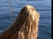 Beautiful blonde with great tits fucks outside on a boat and tropical island