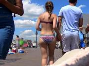 Bikini Babe Strolling on Boardwalk