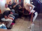 Blonde stripper in a biker bar