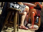 girls sexy crossed legs feets under table