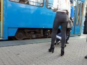 Girl wait for tram 12