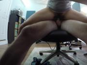 Under desk shot of cute milf wife riding me in office chair