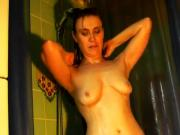 Brunette mature with incredible long hair showering