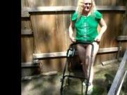 Candid milf doing yard work in bikini