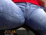 Spanish brunette girl in tight jeans