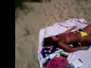 Mature beach voyeured topless caught!