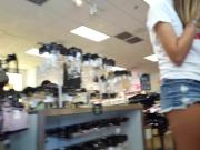 Candid voyeur teen in short shorts shopping