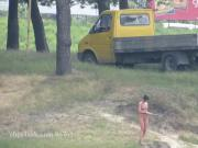 Ola walking alone naked on a public beach voyeur version