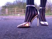 Silver heels walking floor view.MP4